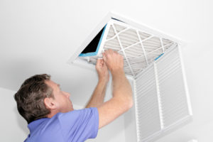 Man In Air Duct Cleaning Process